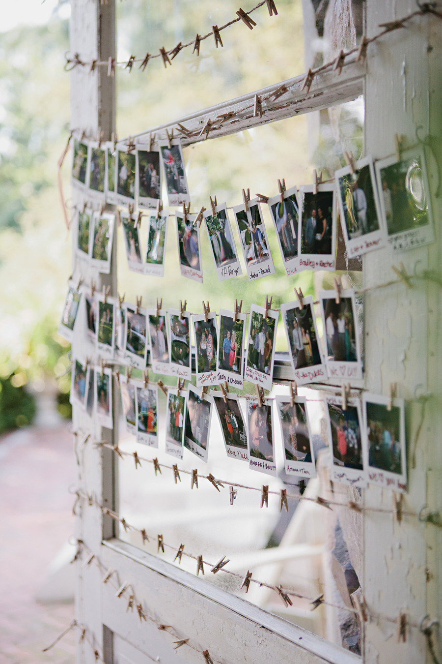 Polaroids hanging from thread